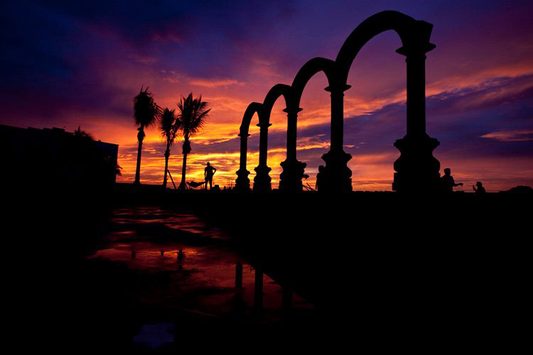 Photo by Josef Kendall - Sunset before the storm under the arches of the newly constructed boardwalk of Puerto Vallartadall
